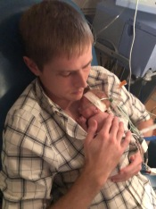 Brian's first time holding Quinn